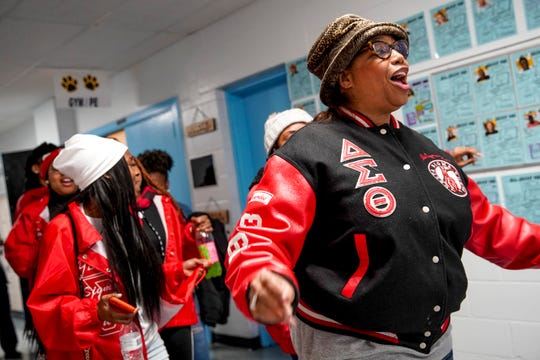"Delta Sigma Theta ""Reds"" sorority sisters dance through the hallway after festivities wrap up at Burt Elementary in Clarksville, Tenn., on Monday, Jan. 20, 2020."