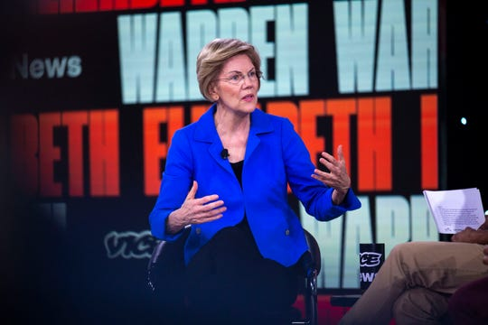 U.S. Sen. Elizabeth Warren, D-Mass., speaks to the crowd and takes questions during the Brown and Black Forum on Monday, Jan. 20, 2020, at the Iowa Events Center in Des Moines.