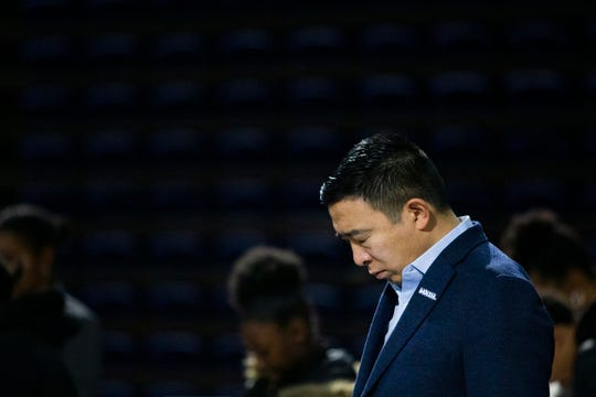 2020 Democratic presidential candidate Andrew Yang bows during a group prayer at the 7th Annual Dr. Martin Luther King Jr. Prayer Breakfast on Jan. 20, 2020 at the Knapp Center at Drake University.
