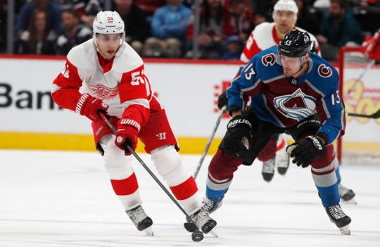 Red Wings center Valtteri Filppula, left, collects the puck as Avalanche right wing Valeri Nichushkin pursues in the second period on Monday, Jan. 20, 2020, in Denver.