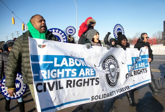 Members of the UAW march during the 35th Annual Peace Walk in Southfield Monday, Jan. 20, 2020 to commemorate the life of civil rights icon Martin Luther King Jr.
