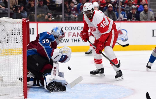 Red Wings right wing Givani Smith shoots the puck on Avalanche goaltender Pavel Francouz the first period on Monday, Jan. 20, 2020, in Denver.