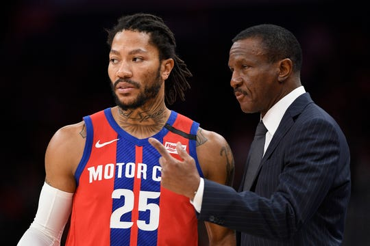 Pistons coach Dwane Casey, right, talks with guard Derrick Rose during the first half on Monday, Jan. 20, 2020, in Washington.