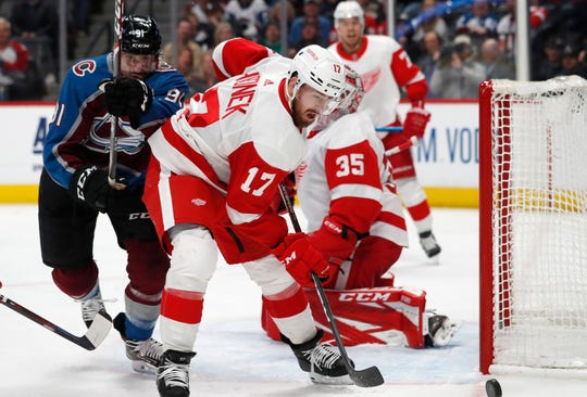 Red Wings defenseman Filip Hronek, front, clears the puck as Avalanche center Nazem Kadri, left, pursues in the first period on Monday, Jan. 20, 2020, in Denver.