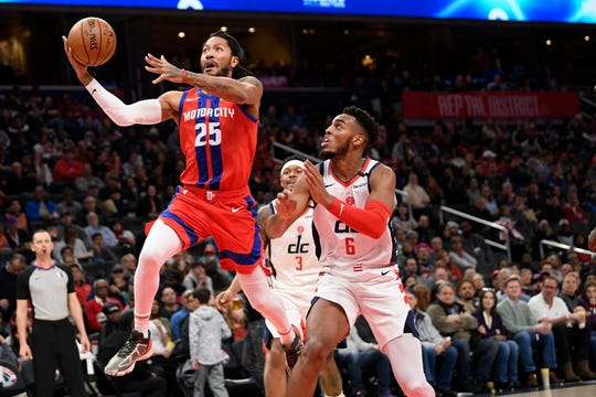 Detroit Pistons guard Derrick Rose (25) goes to the basket past Washington Wizards guard Troy Brown Jr. (6) during the first half of an NBA basketball game, Monday, Jan. 20, 2020, in Washington. (AP Photo/Nick Wass)