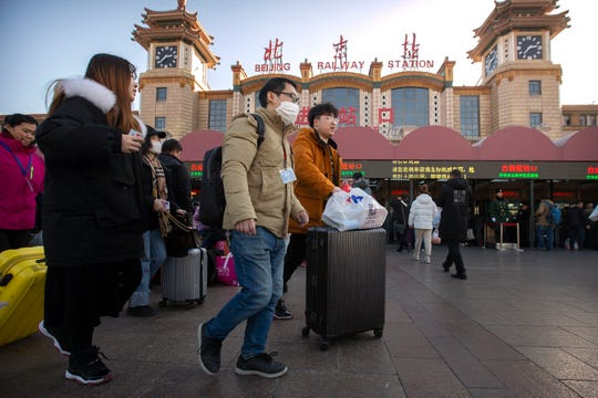 The outbreak coincides with the country's busiest travel period, as millions board trains and planes for the Lunar New Year holidays.
