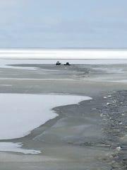 Snowmobiles fall through ice on Houghton Lake.