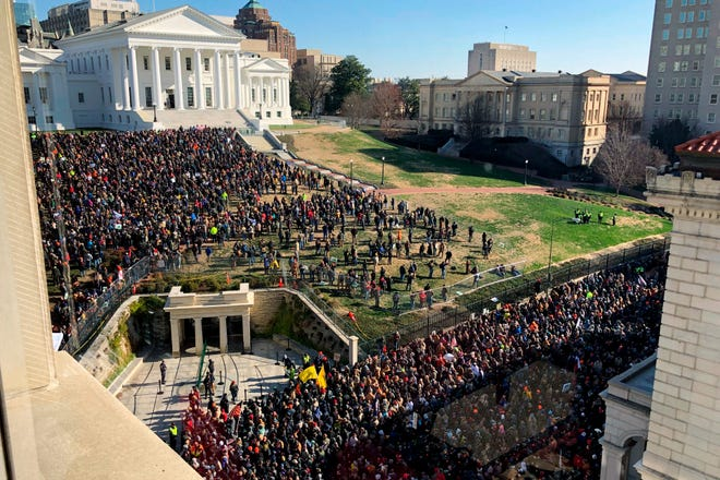 Demonstrators are seen during a pro-gun rally, Monday, Jan. 20, 2020, in Richmond, Va.