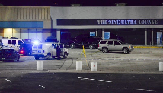Kansas City, Mo., police investigators gather evidence at the scene of a shooting at a nightclub in the early hours of Monday, Jan. 20, 2020, in Kansas City, Mo. Police say an armed security guard may have shot and killed a man suspected of fatally shooting a woman and injuring 15 more people outside a bar in Kansas City.