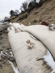 Enormous sand bags have been placed along the shoreline of Lake Michigan to protect houses close to the water in Holland, Michigan.