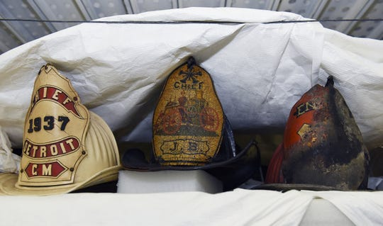Former Detroit Fire Chief helmets are on display inside the warehouse.