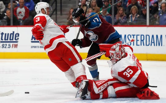 Red Wings goaltender Jimmy Howard, right, was busy on Monday, making 40 saves, but it wasn't enough to beat the Avalanche.