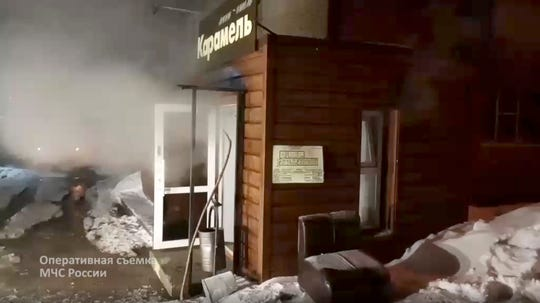 In this image made from video, a damaged hotel of nine rooms located in the basement of a residential building which was flooded with boiling water after a pipe ruptured in Perm, Russia, Monday, Jan. 20, 2020.