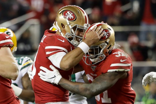 San Francisco 49ers running back Raheem Mostert, right, celebrates his touchdown with quarterback Jimmy Garoppolo during the second half.