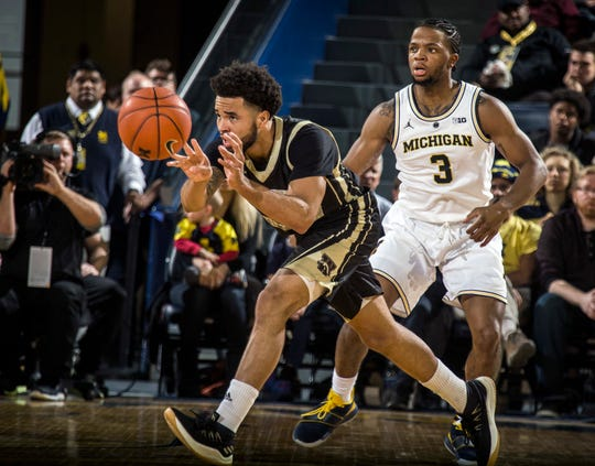 Western Michigan guard Michael Flowers, left, shown here against Michigan last season, is averaging a career-high 18.1 points, shooting 45 percent from 3-point range his last eight games.