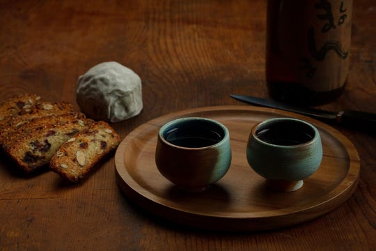 Most of the acidity in sake comes from lactic acid, and the high glutamate content delivers an umami punch, which makes the drink a perfect companion for artisan cheese. (E. Jason Wambsgans/Chicago Tribune/TNS)