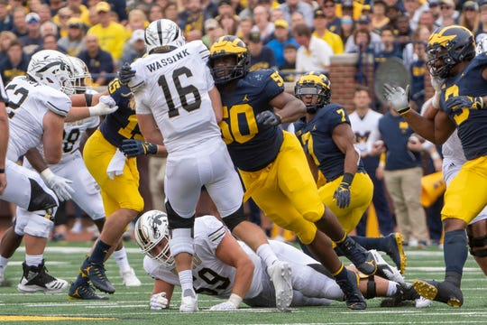 Michigan defensive lineman Michael Dwumfour appeared in 33 games for the Wolverines, with four career starts.