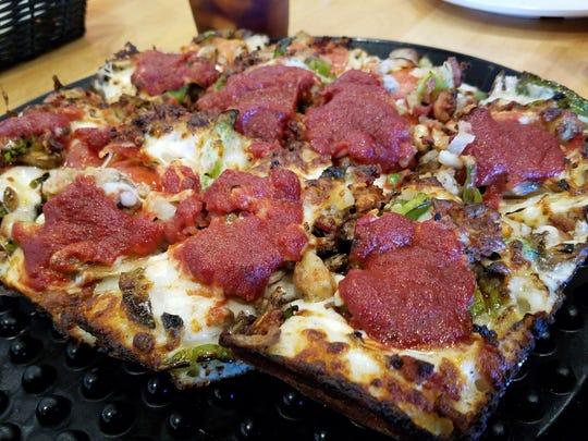 A deep-dish Sicilian pizza at the Noble Roman's Craft Pizza and Pub.