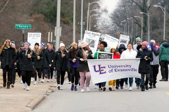 People fill the westbound lane Lincoln Ave. during the University of Evansville's Martin Luther King, Jr. Day symbolic walk recreating the 1963 Civil Rights March on Washington, D.C. Monday afternoon, Jan. 20, 2020.