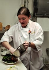 Chef Janice Sandoval prepares Panzanella at The Red Geranium in New Harmony.