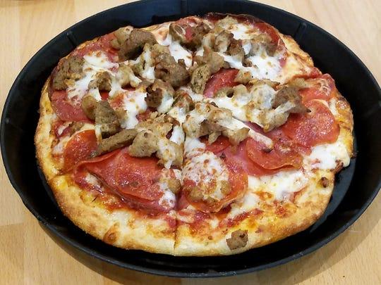 A Meaty Mafioso pizza at the Noble Roman's Craft Pizza and Pub.