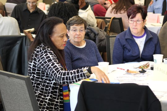 Dr. Regina Vincent-Williams, president of the Fremont NAACP branch, speaks at a leadership table Monday at the 20th Annual Dr. Martin Luther King Jr. Breakfast, held at Terra State Community College's Neeley Center. About 100 people attended the event.