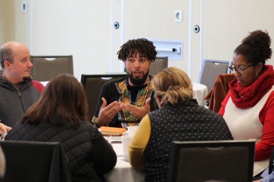 About 100residents spread out among 10 conference tables at the Terra State facility to talk about concerns about leadership, education, housingand zoning, youth programsand LGBTQ inclusion and offer solutions at Monday's annual Dr. Martin Luther King Jr. event.