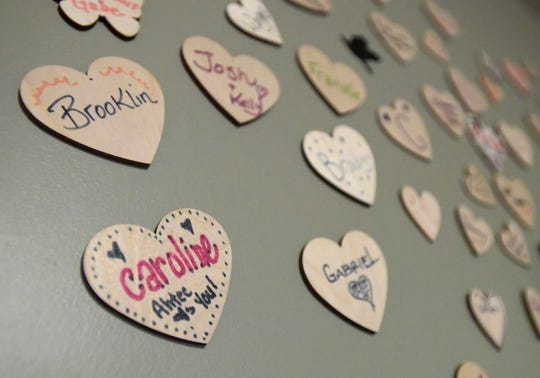 Names fill the wall during a volunteer training session at 3Hopeful Hearts in Fort Collins, Colo. on Thursday, January 16, 2020. The Fort Collins nonprofit that supports grieving parents needs help finding a home to continue its work.