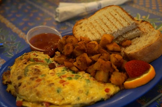Over Easy Cafe offers more than a dozen omelets on its all-day breakfast menu, including this Mexican version.