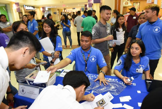 High School students get service learning passports stamped at informational booths in Agana Shopping Center's center court, Hagåtña, Jan. 20, 2020.
