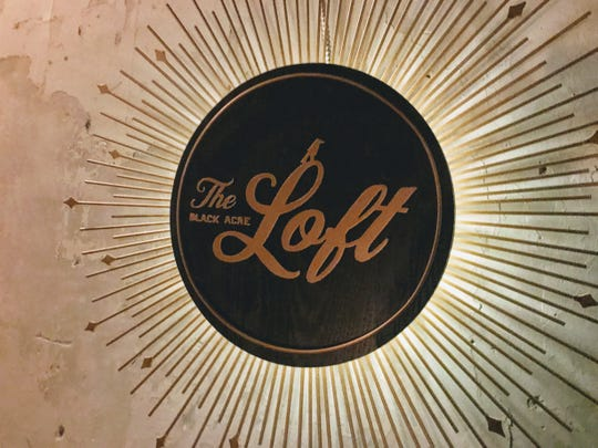 The Black Acre Loft, featuring this sign in its stairwell at 130 N. Delaware St., will open Jan. 24.