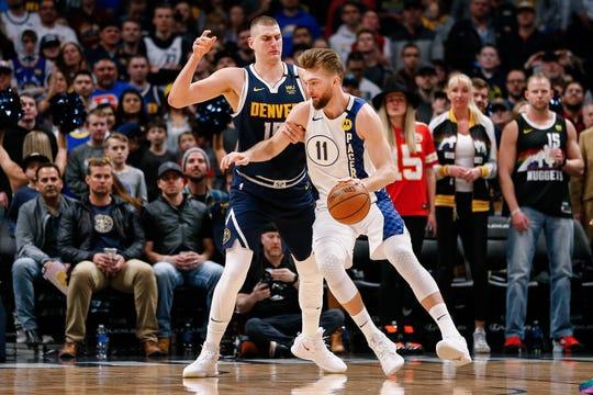 Jan 19, 2020; Denver, Colorado, USA; Indiana Pacers forward Domantas Sabonis (11) controls the ball as Denver Nuggets center Nikola Jokic (15) guards in the first quarter at the Pepsi Center.