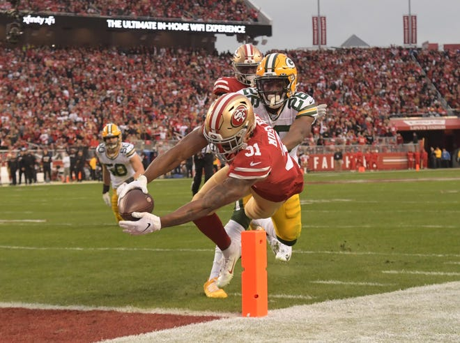 Jan 19, 2020; Santa Clara, California, USA; San Francisco 49ers running back Raheem Mostert (31) scores a touchdown past Green Bay Packers free safety Darnell Savage (26) in the second quarter of the NFC Championship Game at Levi's Stadium.