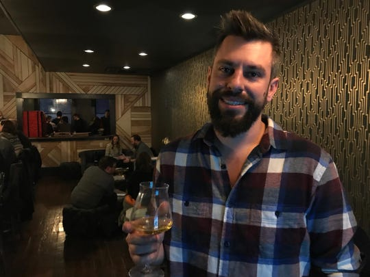Black Acre Brewing Company co-founder Justin Miller welcomed guests during a preview night at the Loft.