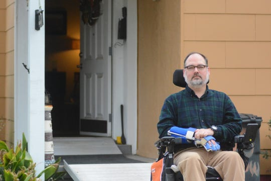 Scott Crawford, a former clinical psychologist and advocate for those with disabilities, sits outside his home on Choctaw Road on Jan. 18, 2020. Crawford and other neighbors are pushing for FEMA and city assistance to move out of their flood-prone homes.