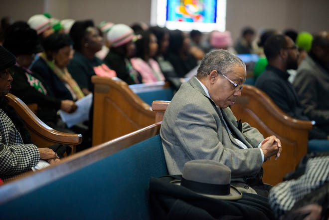 Senior Pastor Rev. Dr. Claude A. Bass, from St. Paul Chistian Methodist Episcopal church prays and bows his head during a memorial service for Dr. Martin Luther King Jr.. NAACP hosts the MLK memorial service at Mt. Zion Baptist Church  after a small Freedom March in Jackson, Tenn., Monday, Jan. 20, 2020.