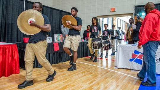 The Northside High Drumline march in after the prayer breakfast Monday, Jan, 20, 2020.