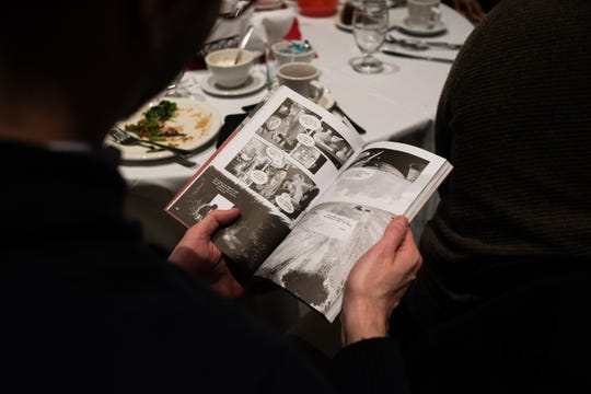 """A celebrant reads Vol. 1 of """"March,"""" a graphic novel about U.S. Rep John Lewis, D-Ga., Monday, Jan. 20, 2020, during the 35th Annual Martin Luther King Jr. Day of Celebration Luncheon at the Lansing Center.  Lewis was slated to speak at the event but was unable to attend due to his fight with pancreatic cancer."""