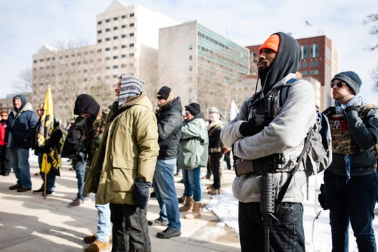 Tory Coleman of Huron Township, right, attends a rally Monday, Jan. 20, 2020, at the State Capitol in downtown Lansing where fellow Second Amendment advocates rallied in support of gun right advocates in Virginia.