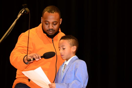 First-grader Mikyle Bowie reads an essay on what Martin Luther King Jr. means to him.