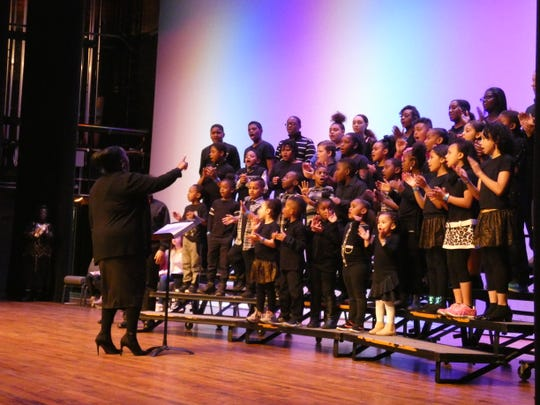 A youth choir performs at the 13th Peace and Freedom Breakfast in honor of Martin Luther King Jr. at the Marion Palace Theatre.