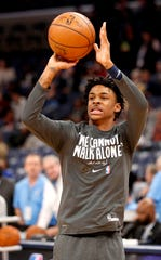 Grizzlies' Ja Morant takes a shot while warming up Monday, Jan. 20, 2020, before a game against the Pelicans at the FedExForum in downtown Memphis. Players wore shirts adorned with a Dr. Martin Luther King Jr. quote while warming up.