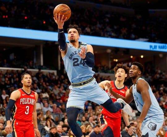 Grizzlies' Dillon Brooks (24) is fouled as he goes up at the net Monday, Jan. 20, 2020, during a game against the Pelicans at the FedExForum in downtown Memphis.