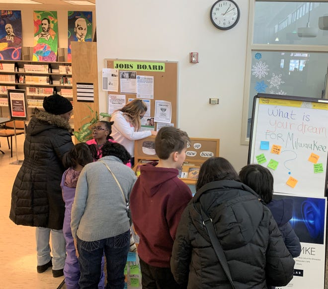 Parents and students alike took the time to write their dreams on sticky notes at the Martin Luther King Library on King Drive in Milwaukee.