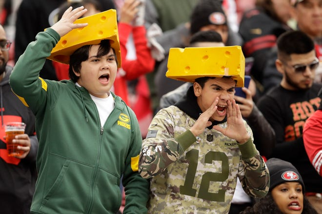 Green Bay Packers fans yell before the NFL NFC Championship football game between the San Francisco 49ers and the Packers Sunday, Jan. 19, 2020, in Santa Clara, Calif.