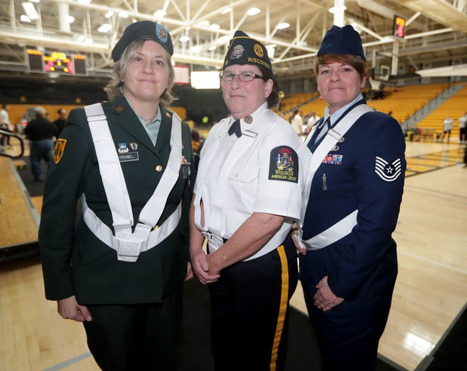 From left, Dawn Strobel, Color Guard officer, Kimberly Stuart, Veterans for Diversity founder, and Denise Northway, American Legion Post 18 Adjutant, are seen before being honored as part of a University of Wisconsin-Milwaukee Women's Basketball Pride Game at Klotche Center in Milwaukee on Jan. 19.