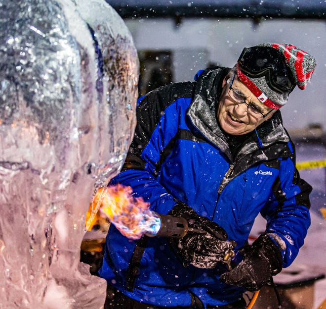 John Haas of Pewaukee works on an ice sculpture during the opening ceremonies of the Waukesha Janboree at Lowell Park on Friday, Jan. 17, 2020.
