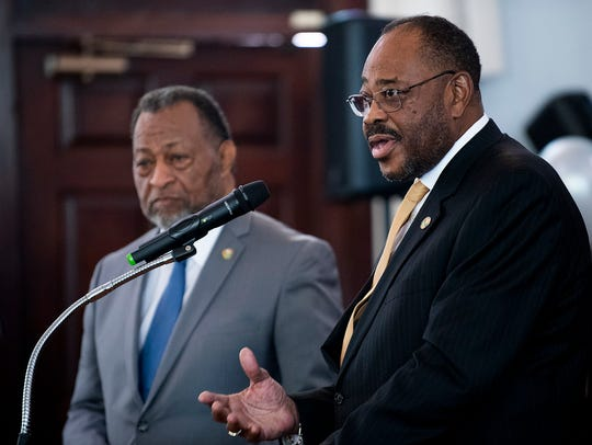 County Commission chairman Elton Dean, left, and Dan Harris speak as the Martin Luther King, Jr., day celebration is held at Dexter Avenue King Memorial Baptist Church in Montgomery, Ala., on Monday January 20, 2020.
