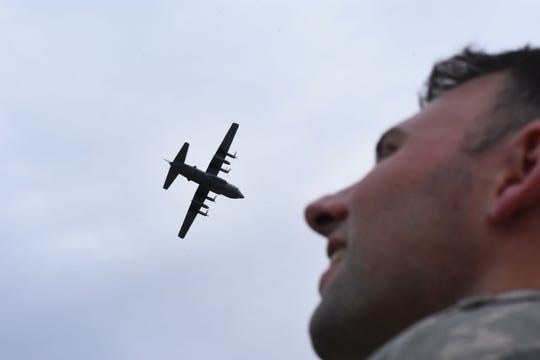 U.S. Air Force Capt. Patrick Mills watches the return of one of the 908th Airlift Wing's C-130 Hercules. The planes temporarily relocated earlier last week as part of the weather evacuation plan.