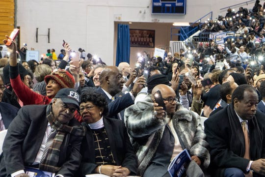 People demonstrate light during the MLK Day Convocation organized by the Interdenominational Ministers Fellowship at Tennessee State University Monday, Jan. 20, 2020, in Nashville, Tenn.
